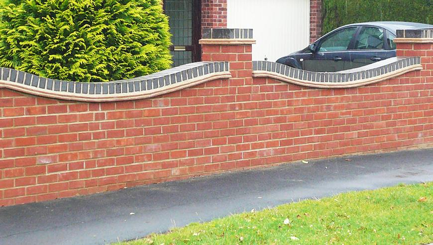 Costs of building a garden wall for Brick house construction cost