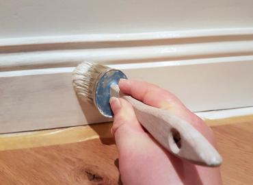 skirting board being painted